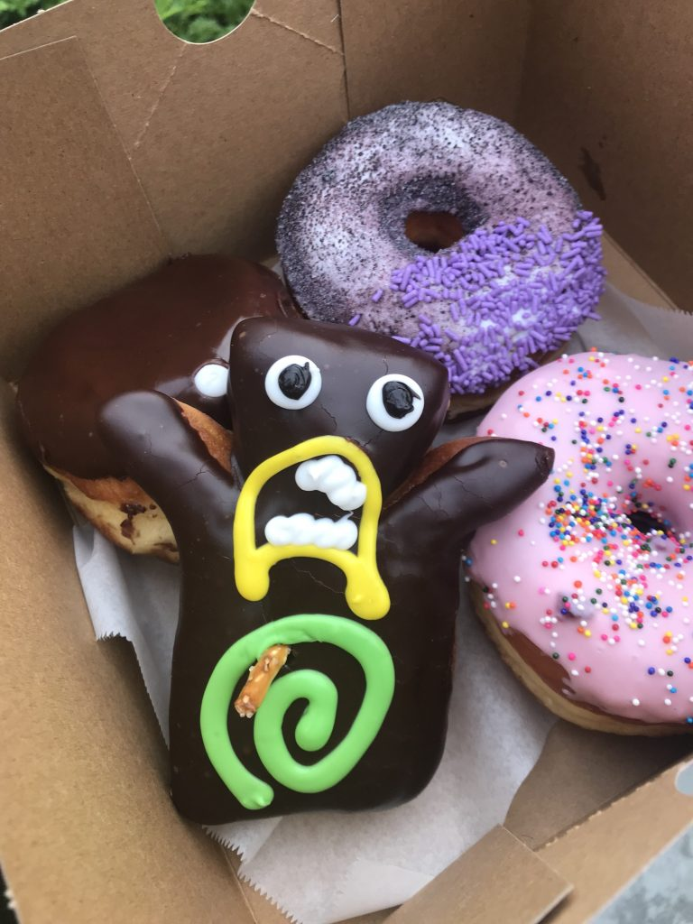Donuts from VooDoo Doughnut: Portland Cream, Grape Ape, Little Pink/Homer, and VooDoo Doll
