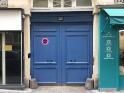 Plain stone, blue doors.