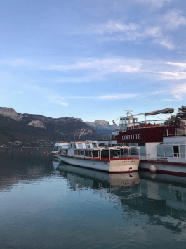 Boats on lovely Lake Annecy. Look at that water. Look at that view!