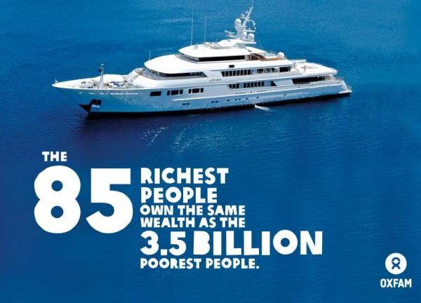 A superyacht moored in a blue blue sea with text added (see caption)