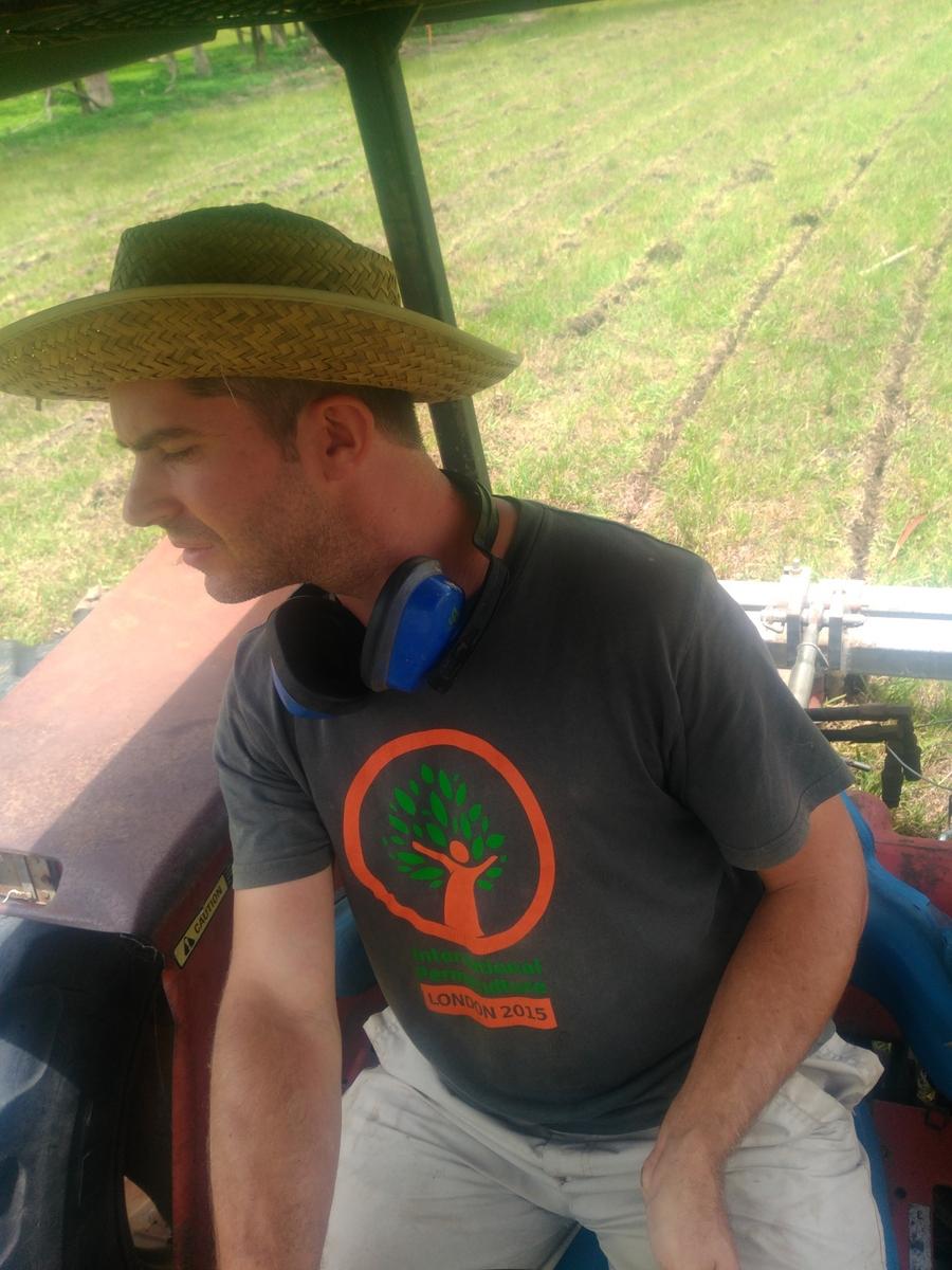 Dan at the helm, furrows behind
