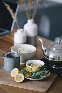 Pretty teacup on a wooden table.