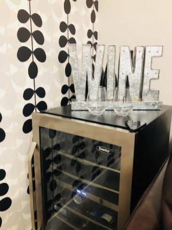 If you are parents ... you need a well stoked bar fridge like this one! Mom found this perfect sign at Home Sense and the his and hers wine glasses were only 9$