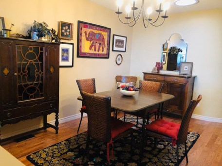Shirley walks by her dining room daily on the way to her master bedroom so we wanted to ensure she could see her beloved memories. Living well is having items in your home that spark joy- and this is a perfect example.