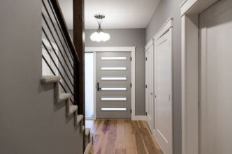 These floors are hickory and are so stunning! They allow for radiant heat and the warm tone pairs well with our cool grey walls- Metropolitan Gray from Benjamin Moore.