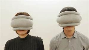 man and woman using small ostrich pillows