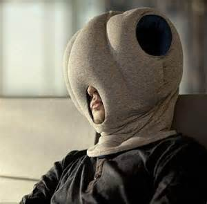 man in airport using ostrich pillow