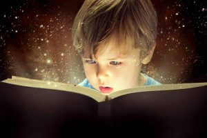 Boy reading book, Reading skills and travel, www.theeducationaltourist.com
