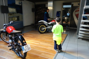 boy in motorcycle shop, travel myths