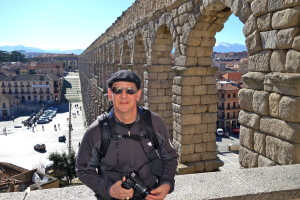man at Segovia's aquaduct, Planning a Family Adventure, www.theeducationaltourist.com