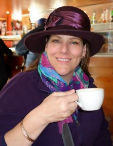 woman in purple hat with tea,  Planning a Family Adventure, www.theeducationaltourist.com