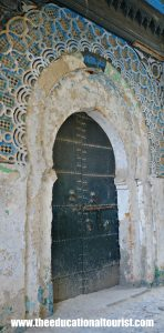 stone keyhole arch with tile in Tangier, Morocco, Moroccan Doors, www.theeducationaltourist.com