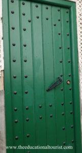 Green door with metal rivets in Morocco, Moroccan Doors, www.theeducationaltourist.com