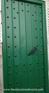Green door with metal rivets in Morocco, Moroccan Doors, www.theeducationaltourist.com