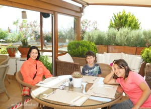 The Educational Tourist and kids at breakfast table in Istanbul, About The Educational Tourist, www.theeducationaltourist.com