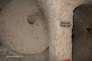 Door to tunnel underground city Kaymakli Turkey UNESCO