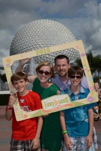 mom, dad, and 2 sons pose for photo at Epcot, Disney Made Easy, www.theeducationaltourist.com