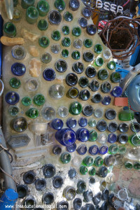 detail of class bottles Cathedral of Junk
