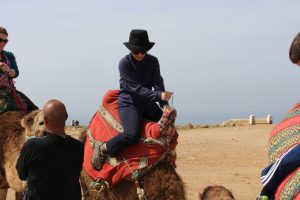 The Educational Tourist riding camel.