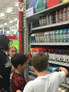 kids choosing spray paint at store, Hope Outdoor Gallery, www.theeducationaltourist.com