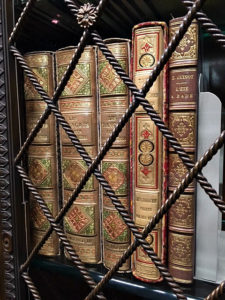 ornate books in a bookshelf in the Morgan Library, Morgan Library, NYC - Visit with KIDS, www.theeducationaltourist.com