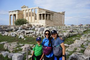 The Educational Tourist and kids on Athens' Acropolis in front of the Caryatids on the Erechtheion