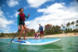 family paddle boarding at Aulani Disney resort in Hawaii