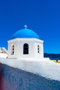 White home with blue roof in Oia, Santorini
