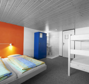 hostel with 2 twin beds and one bunkbed
