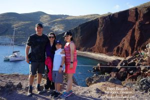 The Educational Tourist's family at red sand beach in Santorini, Greece