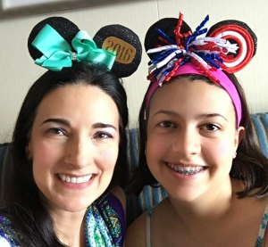 The Educational tourist and young lady wear Mickey Mouse ears on a Disney Cruise
