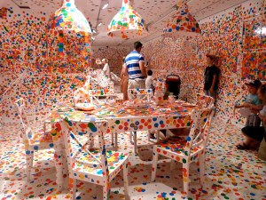 exhibit with stickers by artist Yayoi Kusama, Photos from Mark Sherwood on This Colossal,