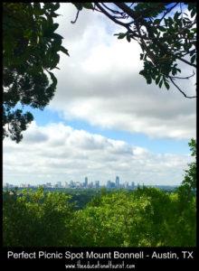 austin skyline through trees mount bonnell
