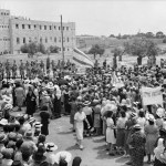 Jewish_anti_Palestine_White_Paper_demonstrations._Women's_demonstration_on_May_22,_1939._Demonstration_approaching_King_David_Hotel_stopped_by_cordon_of_police_seen_in_distance._matpc.19611