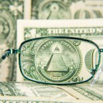 Glasses,Focused,On,Dollar,Banknote,,Dollar,Money,With,Pyramid,And