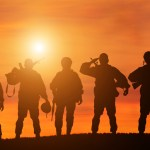 Silhouette,Of,A,Solider,Saluting,Against,The,Sunrise.,Concept,-