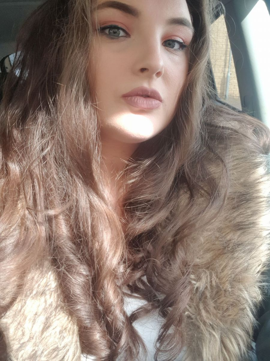 orange eyeshadow, nude lipstick, curly hair