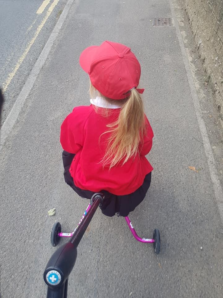 Shaniah on her pink micro trike
