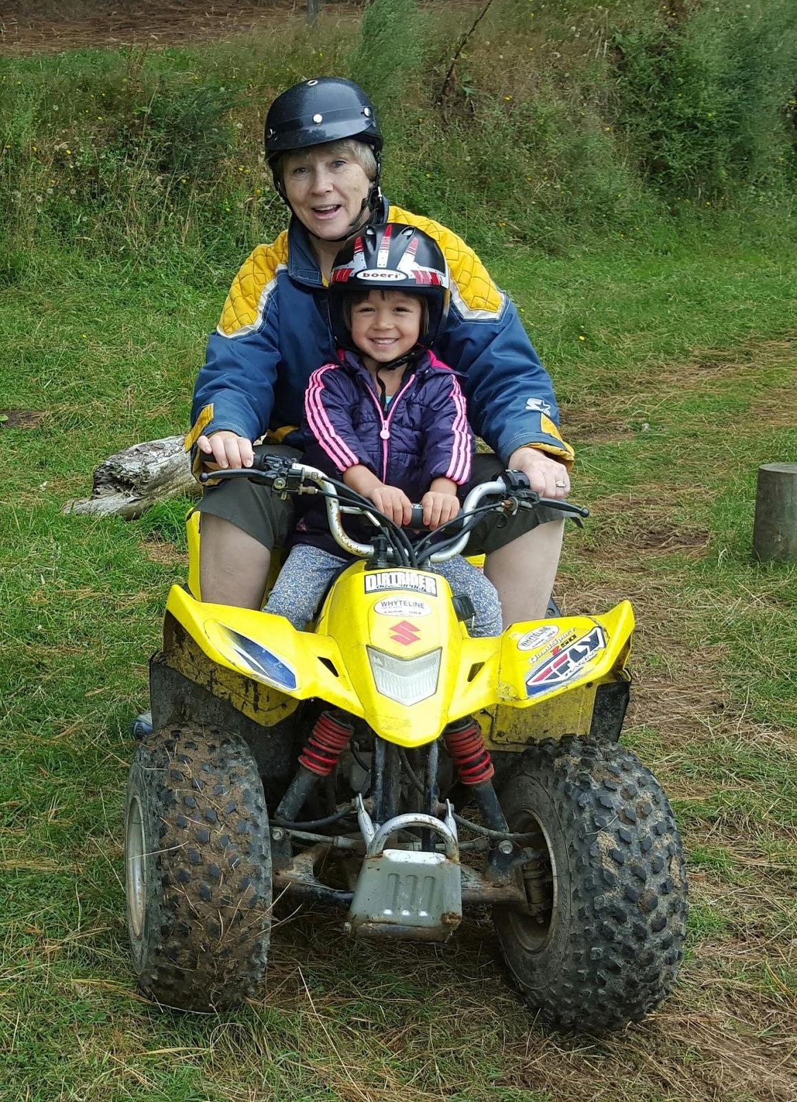 Boy and lady on a quad
