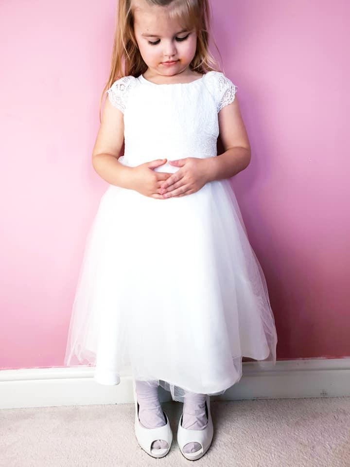 Shaniah in her flower girl dress