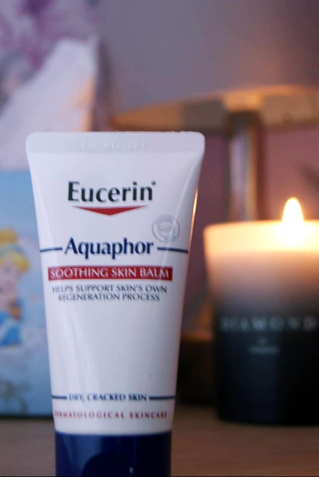 aquaphor by tissues and a candle