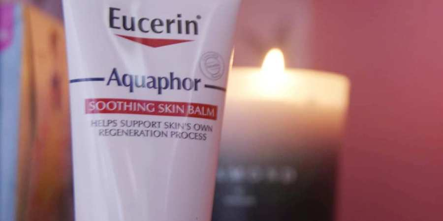 aquaphor in front of a candle