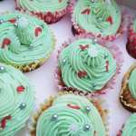 cupcakes with green icing and sprinkles