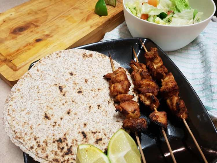 chicken tikka skewers with chapatti and lime