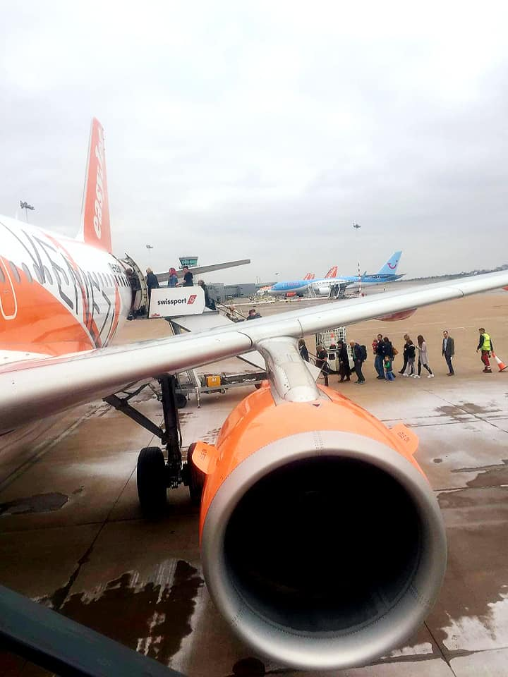 easyjet plane with boarding passangers