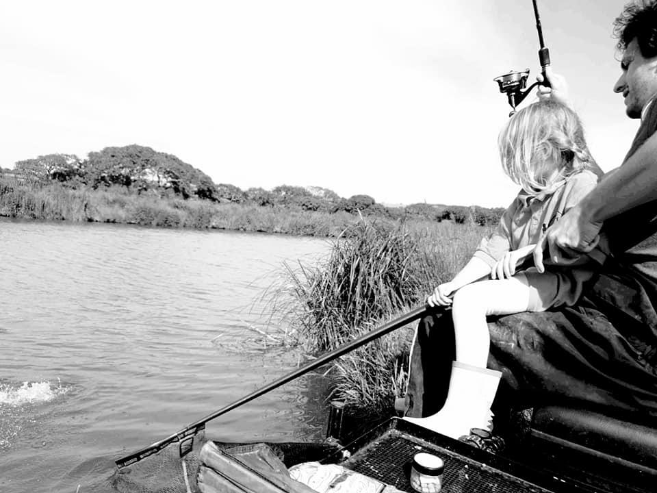 Shaniah and Ryan fishing by a lake.