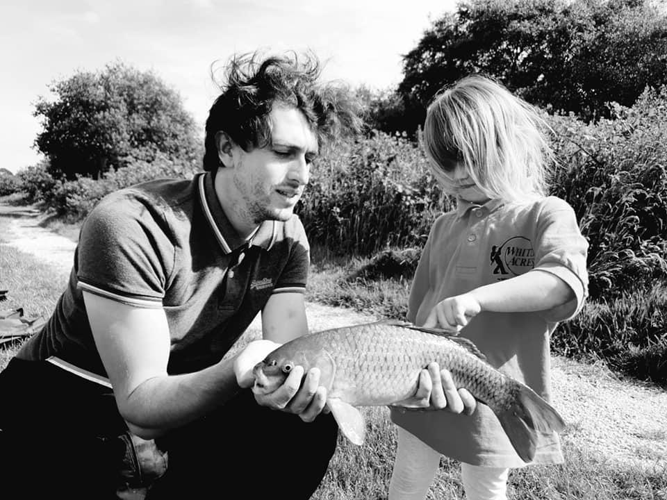 Shaniah and ryan holidng a fish