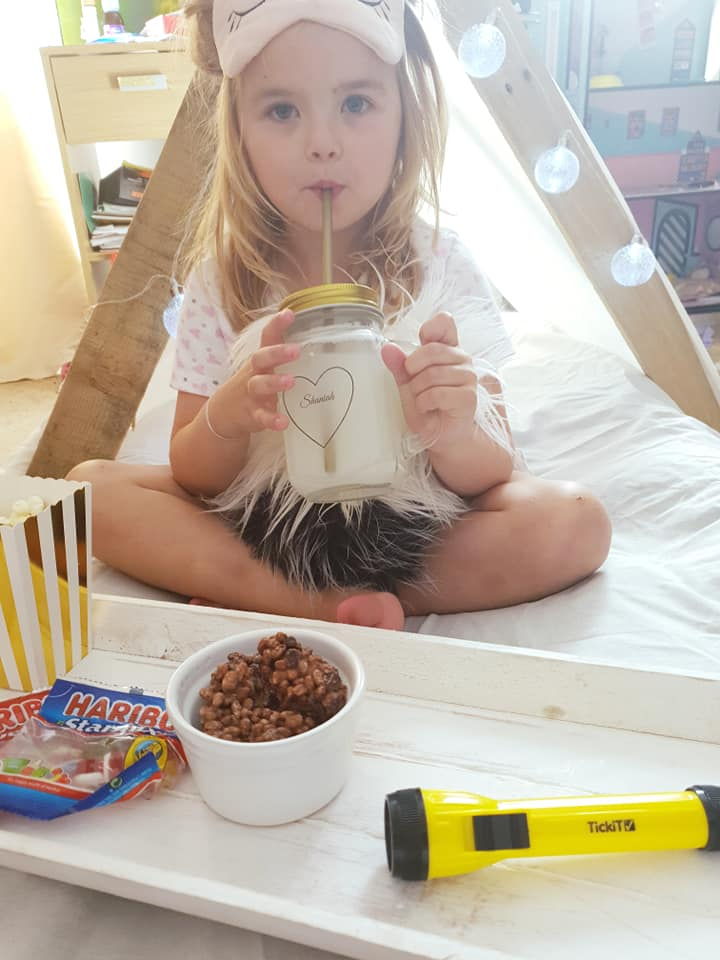 Shanaih sat infront of her fort drinking from her cup