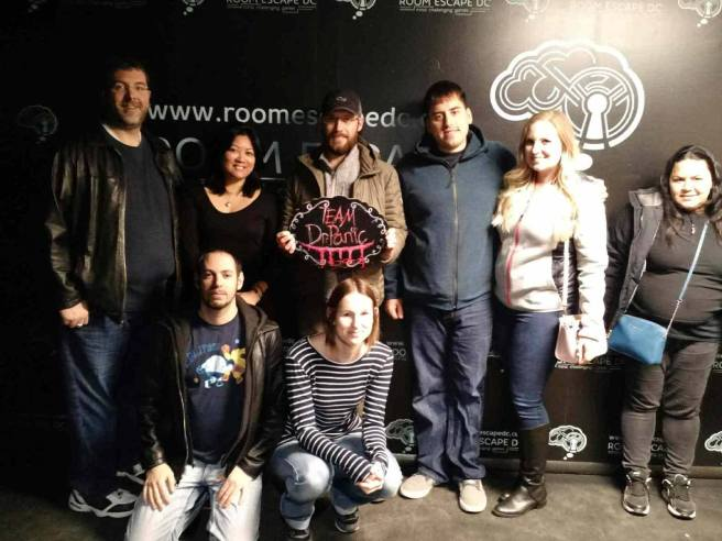 Team Disturbed Friends (Mike, Eric, Mark, Katheryn, Sibel, Jason and Cat) escaped being eternally committed to the asylum by Dr. Panic! Photo courtesy of Room Escape DC's Facebook page.