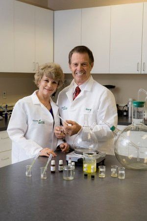 Gary and Mary Young testing oils in the laboratory